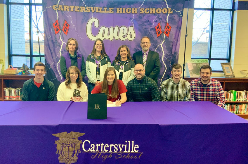 Cartersville senior Grayson Breedlove signed recently to swim at Lenoir-Rhyne in Hickory, North Carolina. On hand for the signing were, from left, front row: Parker Breedlove, Christi Breedlove, Don Breedlove, Kanon Breedlove, Tyler Breedlove; back row, Shelley Tierce, Kim Rentz, Emily Walker and Darrell Demastus.