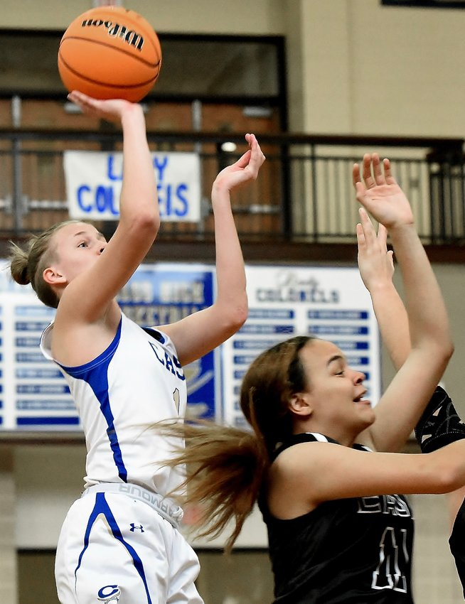 Claire Davis shoots over an East Paulding defender, part of her 27-point effort Saturday in the Colonels' home win.