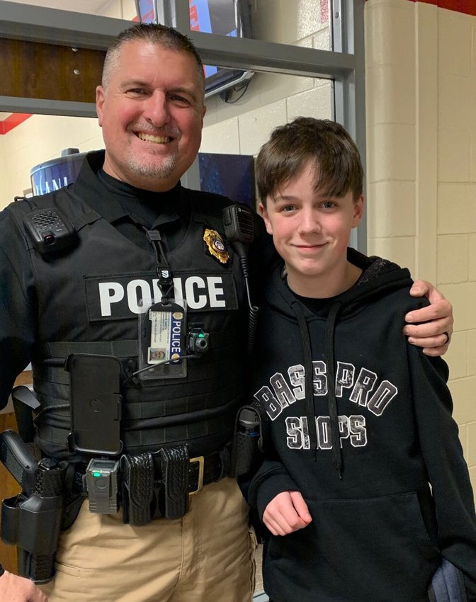 Red Top Middle school resource officer Duane Smith administered the Heimlich maneuver to 11-year-old Ethan Hamrick after the sixth-grader began choking on a water-bottle cap during lunch Tuesday.