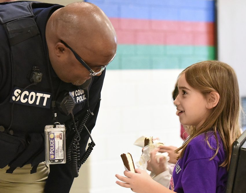 Bartow County school resource officer Donnie Scott talks with Euharlee Elementary first-grader Ryleigh Rieckert during his Ice Cream With a Cop program  Dec. 6 at the school.