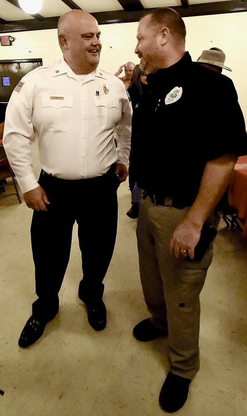 At his retirement party Friday at the Cartersville Civic Center, Bartow County Fire Chief Craig Millsap, left, speaks with Emerson Police Chief Kyle Teems. Prior to their current positions, Millsap and Teems were partners while working with Bartow EMS.