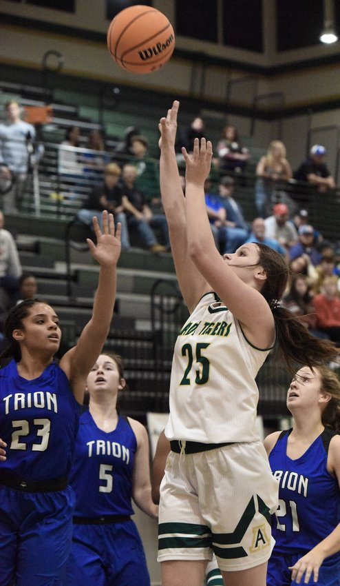 Adairsville sophomore Lexie Childers rises up for a shot against Trion during a semifinal of the AHS Tiger Christmas Clash Saturday in Adairsville. Childers led the Tigers with 12 points in a 63-54 defeat.