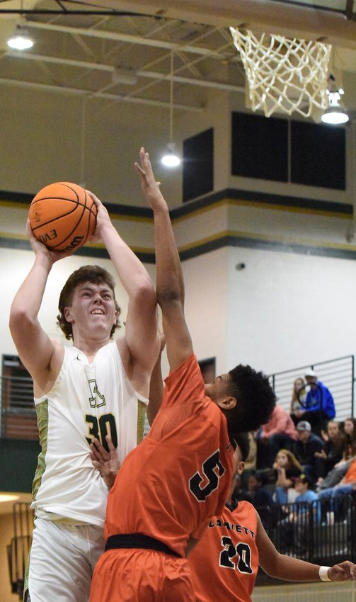 Adairsville senior Jaxon Welchel goes up for a shot against LaFayette in the semifinals of the AHS Tiger Christmas Clash Saturday in Adairsville. Welchel scored a team-high 17 points in a 57-45 loss.