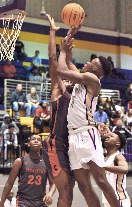 Cartersville junior Kyler Johnson goes up for a shot against Cedartown during Friday's game at The Storm Center. Johnson had six points in the Canes' 59-57 win to open Region 5-AAAA play.
