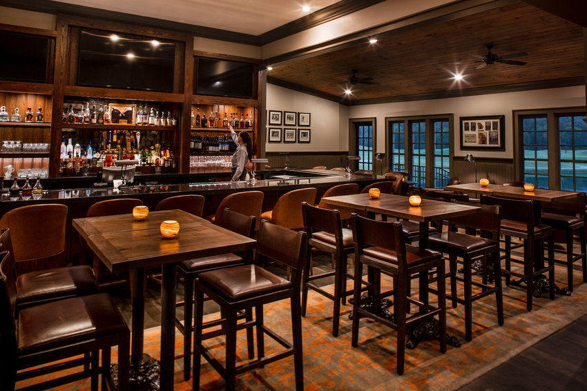 Woodlands Grill's Dugan's recently received numerous enhancements, such as a marble countertop bar and cocktail tables.