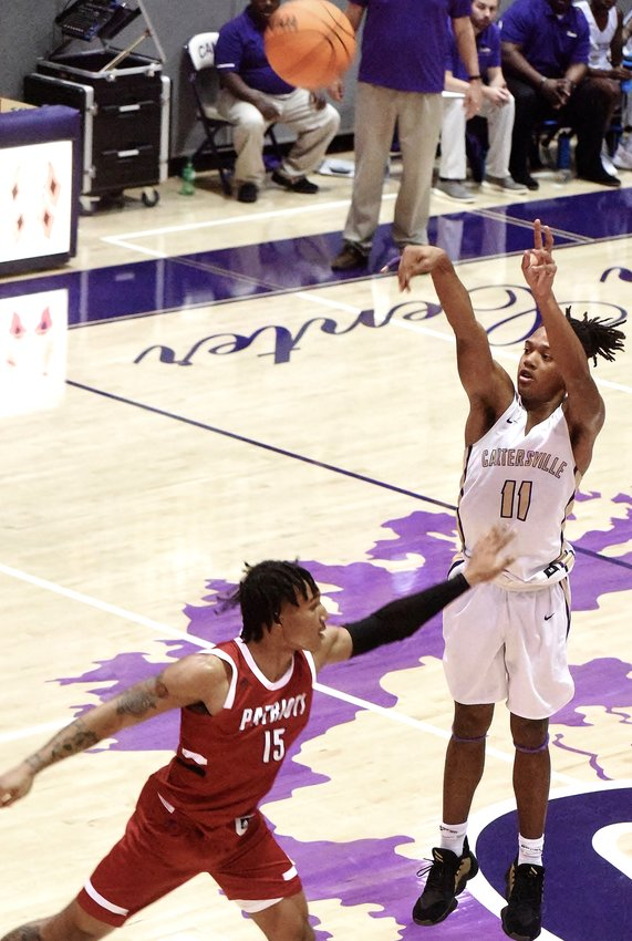 Cartersville junior Kolbe Benham fires from deep against Sandy Creek during Friday's game at The Storm Center. Benham had six 3-pointers and 28 total points in a 76-69 loss.