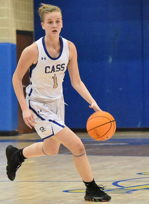 Cass sophomore Claire Davis surveys the floor against Rome during Tuesday's home game. Davis finished with 25 points in a 51-48 win.