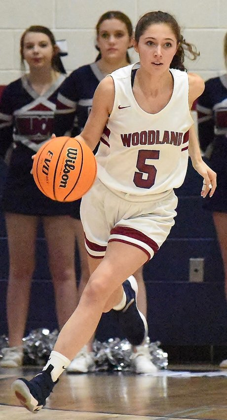 Woodland's Carli Clymer dribbles the ball up the court during Tuesday's win over Paulding County at Woodland High. Clymer finished with 11 points.