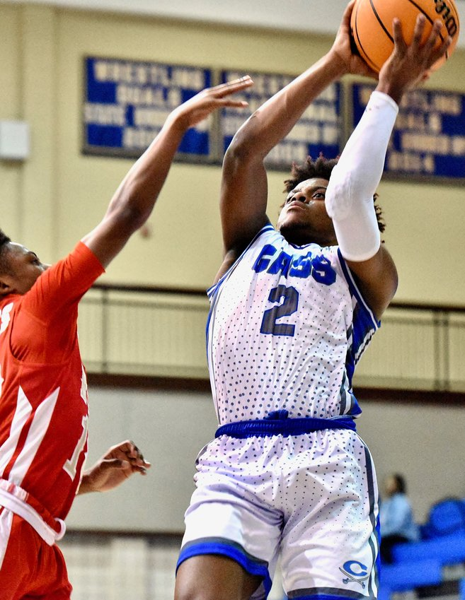 Cass junior C.J. Pipkin goes up for a shot against Rome during Tuesday's home game. Pipkin had nine points in a 68-50 win.