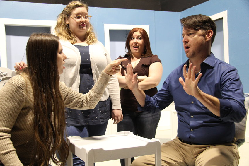 """Cassy Thaxton, from left, Caitlyn Keller, Mallory Holder and Hunter Showalter rehearse a scene from """"Men Are Dogs,"""" where Cecelia (Holder) watches over a group therapy session."""