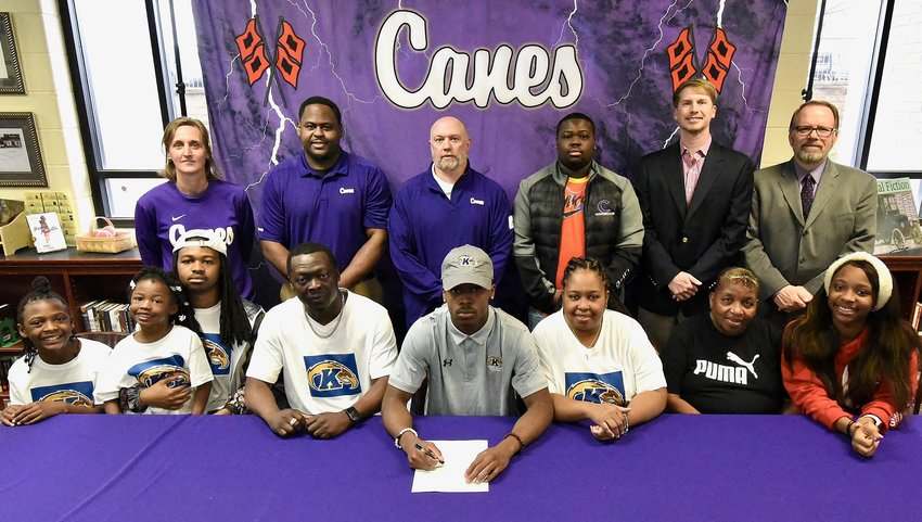 Cartersville senior Marquail Coaxum signed to play football at Kent State Wednesday in the CHS Media Center. On hand for the signing were: from left, front row, Davayah Coaxum, sister; Dalylah Coaxum, sister; Xavior Coaxum, brother; David Coaxum, father; Liswandra Davis, mother; Charlene Maxwell, grandmother; Aliriyah Hamilton, cousin; back row, Shelley Tierce, CHS principal; Jim Jones; CHS assistant; Jeremy Knight, CHS assistant; David Coaxum Jr., brother; Conor Foster, CHS head football coach; and Darrell Demastus, CHS athletic director.