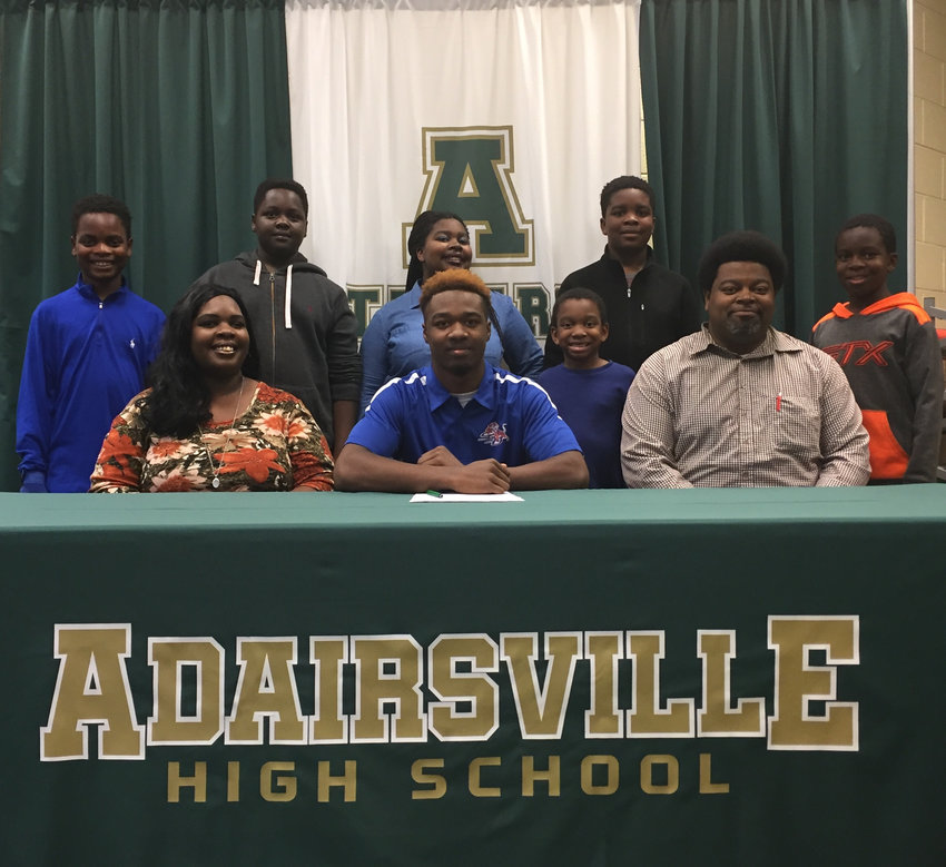 Adairsville senior Malachi Gardner signed to play football at Savannah State during a ceremony Wednesday in the AHS Media Center. On hand for the signing were fellow members of the Gardner family: from left, front row, Shunteé, mother; Larry, father; back row, Samuel, brother; Solomon, brother; Lauryn, sister; Michael, brother; C.J., brother; and Cameron, brother.