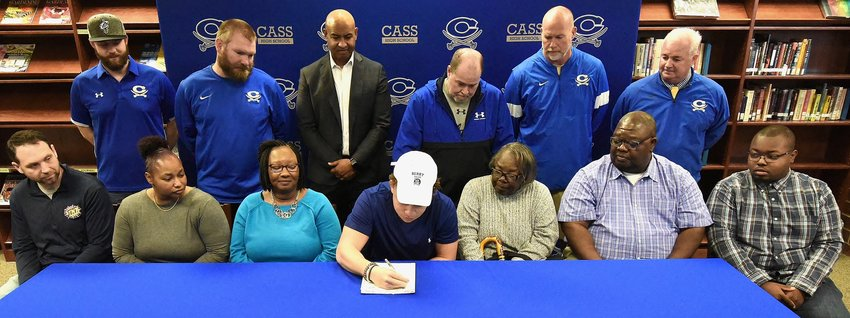 Cass senior J.P. Perry signed to play football at Berry College in Rome Wednesday in the CHS Media Center. On hand for the signing were: from left, front row, Adam Jernigan, rec. coach; Jackie Cox, aunt; Geri Perry, mother; Sarah Cox, grandmother; Dennis Cox, uncle; Zach Taylor, cousin; back row, P.J. Hughes, CHS assistant; Brock Pyle, CHS assistant; Richard Cox, cousin and mentor; Bobby Hughes, CHS head football coach; Jamey Gaddy, CHS assistant; and Nicky Moore, CHS athletic director.