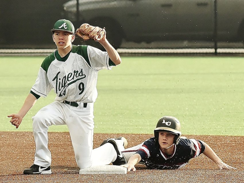 Adairsville shortstop Kyler Smith awaits the call of the field umpire after tagging out a Haralson County baserunner during a game last year.