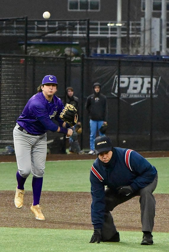 After fielding a ground ball, Cartersville third baseman Drew Rothschild throws across the diamond to get the runner out at first base in the bottom of the second inning during the Canes' game against Etowah High at LakePoint Thursday afternoon.