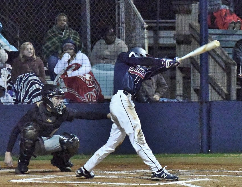 Woodland's Fisher Davis singles against Sprayberry during Friday's home game.