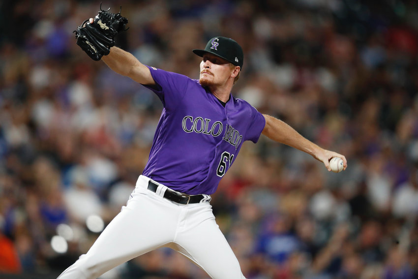 Colorado Rockies relief pitcher Sam Howard works against the Los Angeles Dodgers in the sixth inning of a game July 30, 2019, in Denver. Howard, a former Cartersville High pitcher, made his spring training debut with the Pittsburgh Pirates on Sunday.