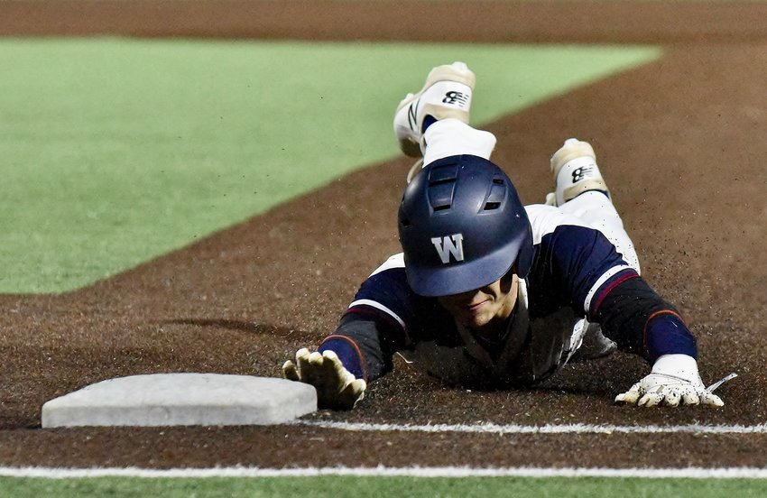 Zach Wilson dives safely back to first during a pickoff attempt Thursday against Adairsville at LakePoint.