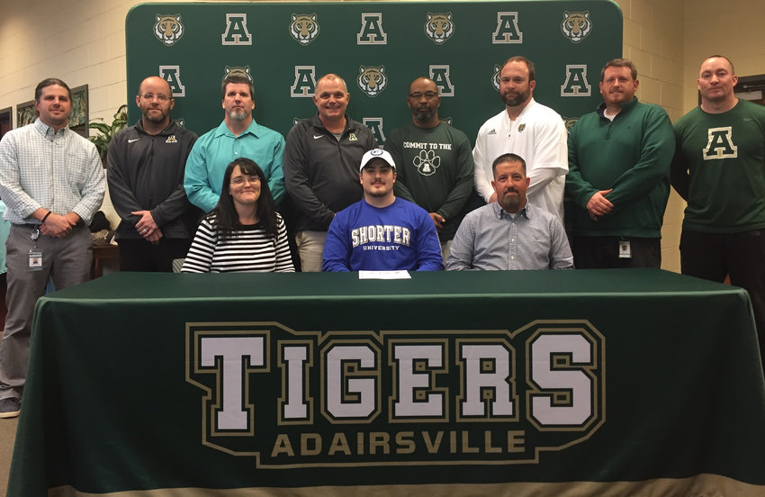 Adairsville senior Garrett Ellis signed recently to play football at Shorter in Rome. On hand for the signing were parents Angela and Jason Ellis, along with coaches, from left, back row, Pat Konen, John Terrell, Tony Sellers, Eric Bishop, Billy Roper, Kurt Scoggins, Robby Stone and Jon Cudd.