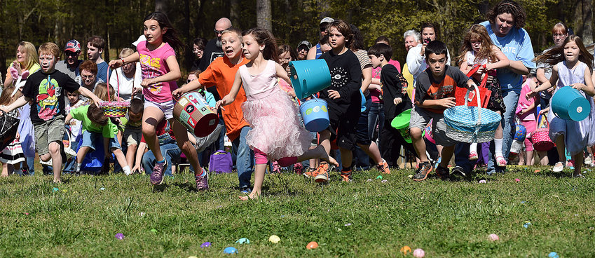 Children race for prizes at Frankie Harris Park during a previous Euharlee Egg Hunt. This year's hunt is canceled due to COVID-19 concerns.