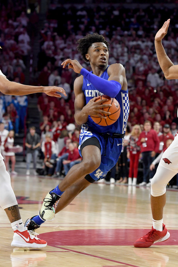 Cartersville native and Kentucky guard Ashton Hagans drives to the basket against Arkansas during a game Jan. 18 in Fayetteville, Arkansas. Hagans announced Sunday he will enter the NBA draft.