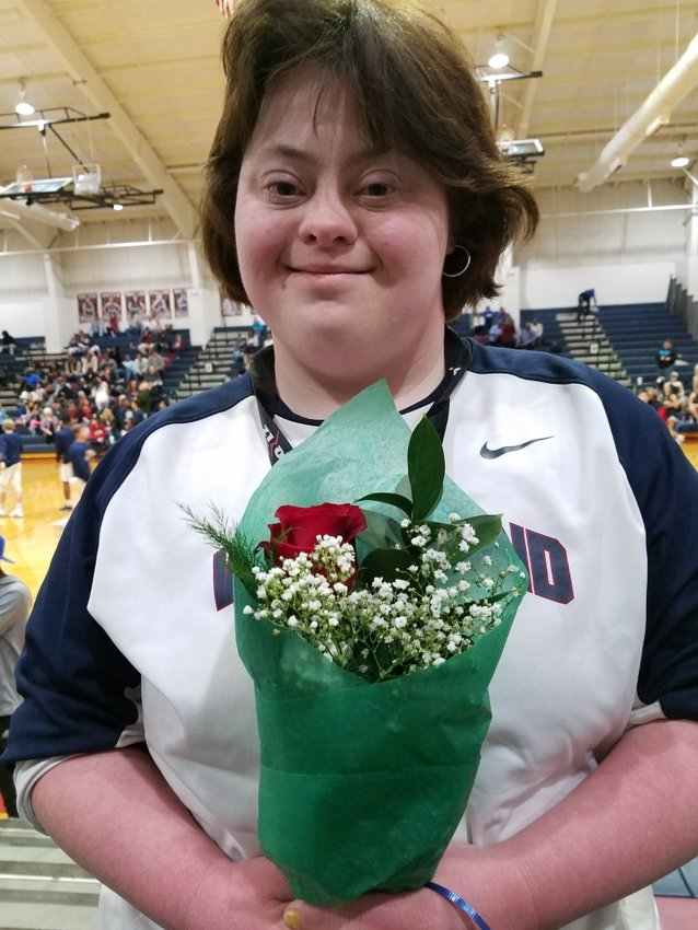 Leah Baines has been the manager of the Woodland High girls basketball team since 2007.