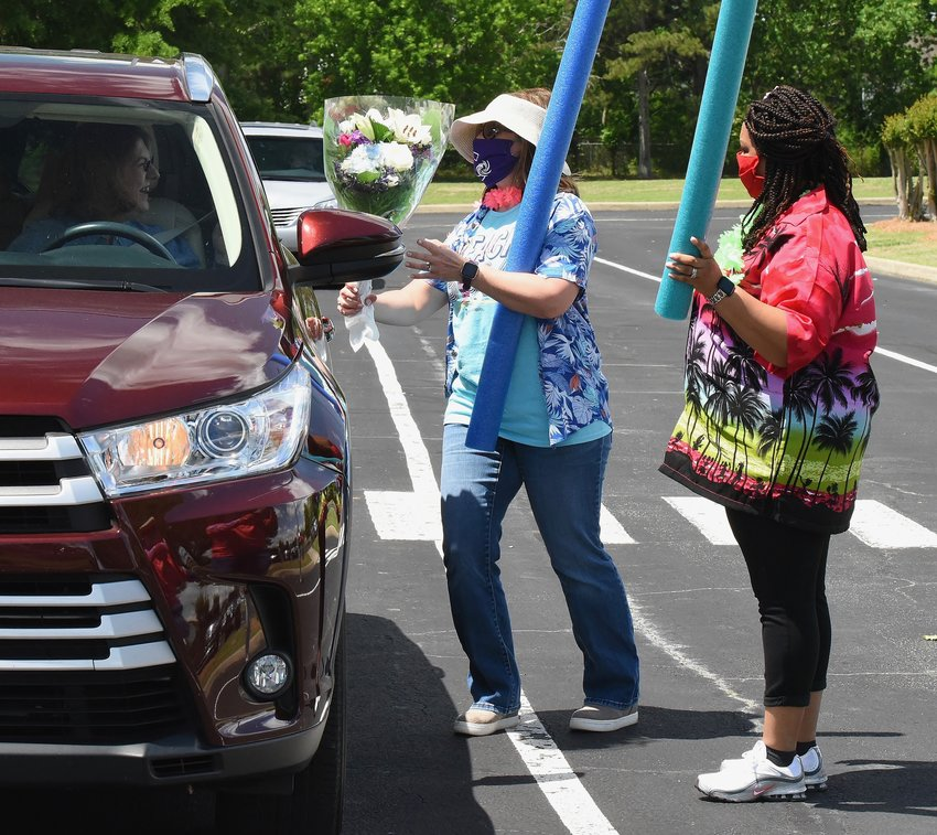 Cartersville Elementary School principal Melissa Bates, left, and CES assistant principal Becky Bryant greet retiring CES gifted teacher Susan Topham at the school's Teacher Appreciation Day Wednesday.