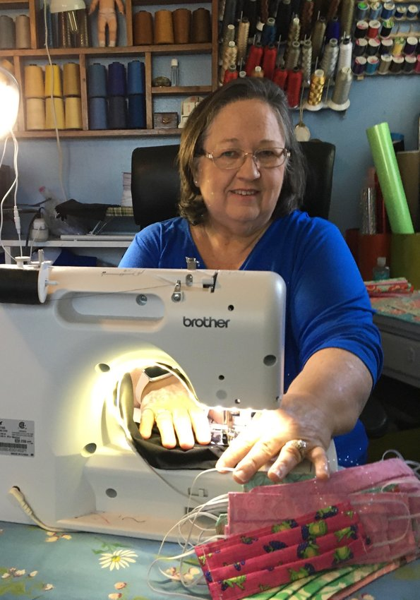 Brenda Harris sews a face mask during the COVID-19 pandemic. Her written story is among those already submitted to the Bartow History Museum's COVID-19 in Bartow County project.