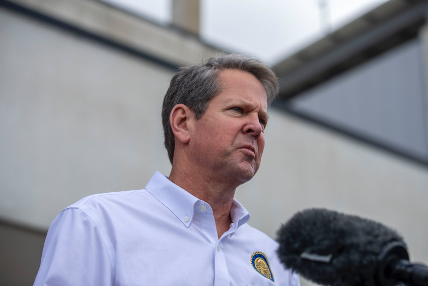 Governor Brian Kemp makes a statement and answers questions from the media following a tour of Fieldale Farms while visiting Gainesville Friday.