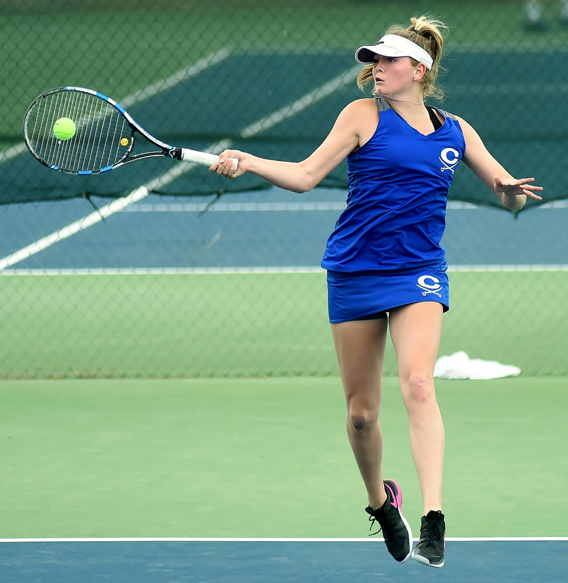 Emily Surcey hits a forehand while playing for Cass High in 2018.