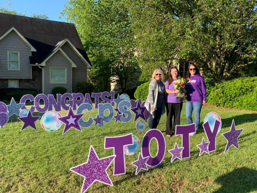 Cartersville Primary School Teacher of the Year Kristen Kearney, center, was surprised by Principal Gina Bishop, left, and Assistant Principal Katie Vaughan on May 7.