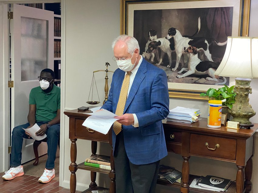 Development Authority of Bartow County legal counsel H. Boyd Pettit, III, standing, leads Friday morning's board meeting.