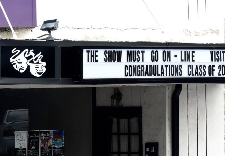 """A portion of The Legion Theatre's marquee reads """"The show must go on."""" With its home theater currently closed to the public, the Pumphouse Players group continues to offer online productions."""