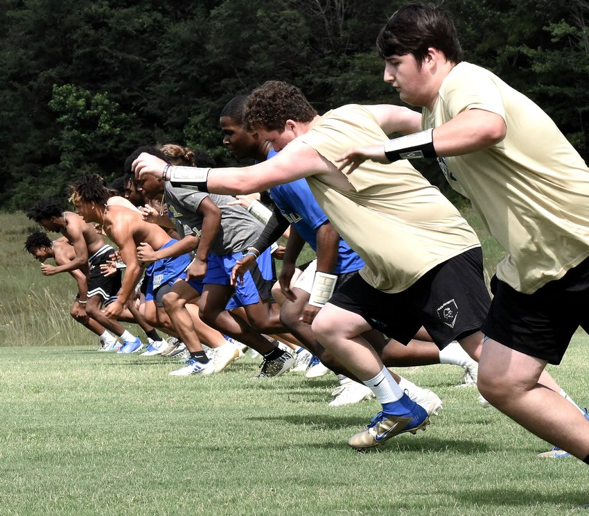 Cass football players take part in conditioning drills during a workout Thursday at the Colonels practice field.