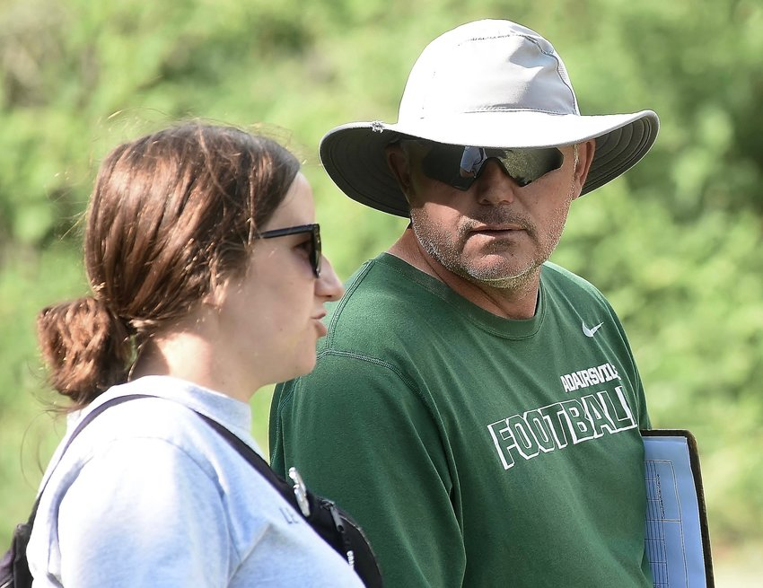 Adairsville athletic trainer Alyson Worthey, left, talks with head football coach Eric Bishop at a 2019 practice.
