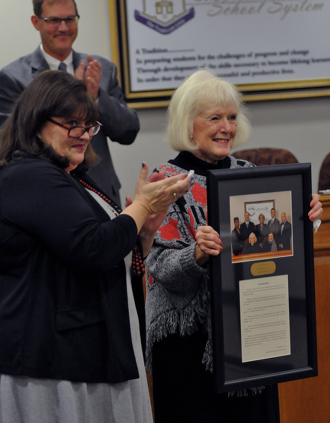 Former Cartersville City School Board President Linda Benton, being honored by board members on her retirement, died Monday at age 77.