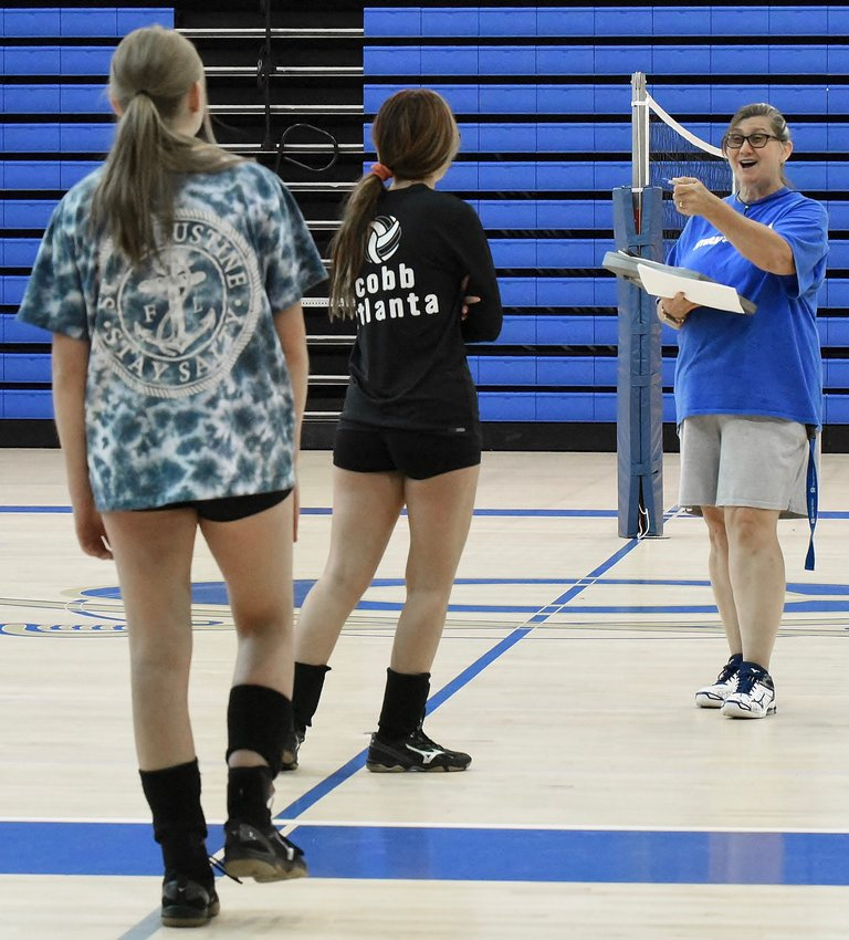 First-year Cass head volleyball coach Laura Hayes addresses her team during workouts Tuesday.