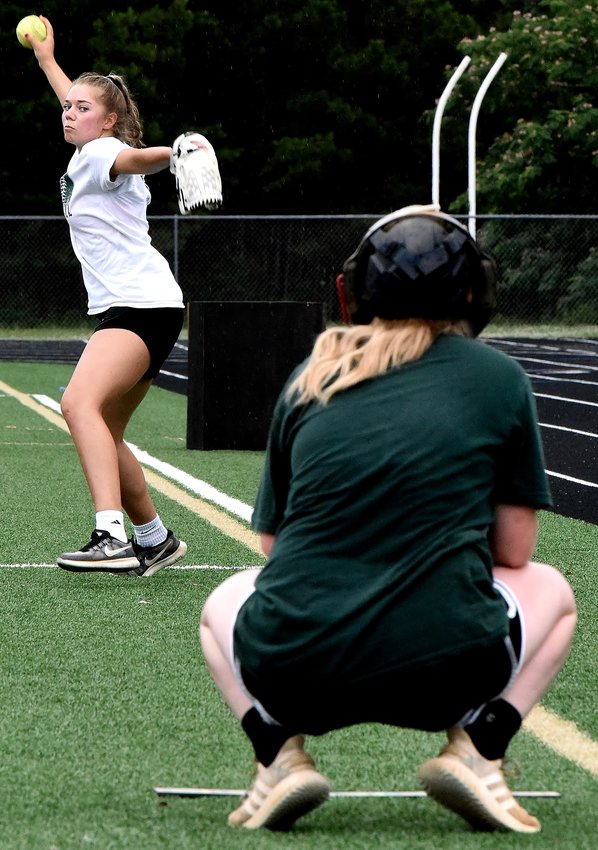 Adairsville rising senior Taylor Rhoades delivers a pitch to rising sophomore Alyssa Jarrett during a softball workout Wednesday at Tiger Stadium.