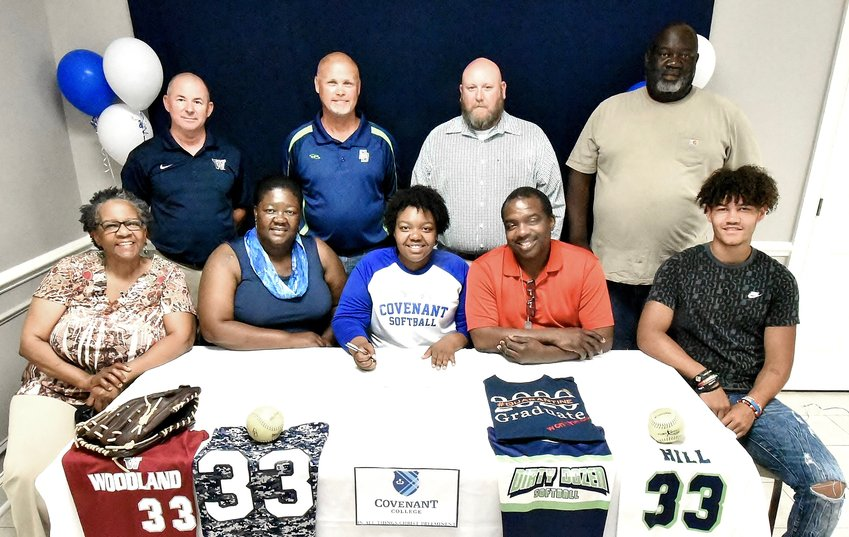 Woodland Class of 2020 graduate Brianna Hill signed June 12 to play softball with Covenant College in Lookout Mountain. On hand for the signing were, from left, front row: Eloise Jackson, grandmother; Delia Hill, mother; Dwayne Hill, father; Evan Smith, cousin; back row, Coleman Roberts, WHS head softball coach; Tim Storey, travel ball coach; Matt Bowen, WHS assistant softball coach; and Kelly Smith, uncle.