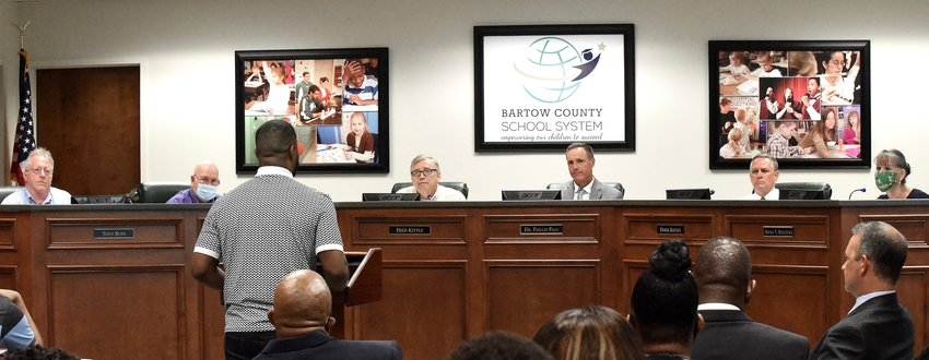 The Rev. Isaiah Robertson addresses Bartow County School Board members, from left, Tony Ross, Terry Lee Eggert, Chairman Fred Kittle, Superintendent Dr. Phillip Page, Derek Keeney and Anna Sullivan at Monday night's meeting.