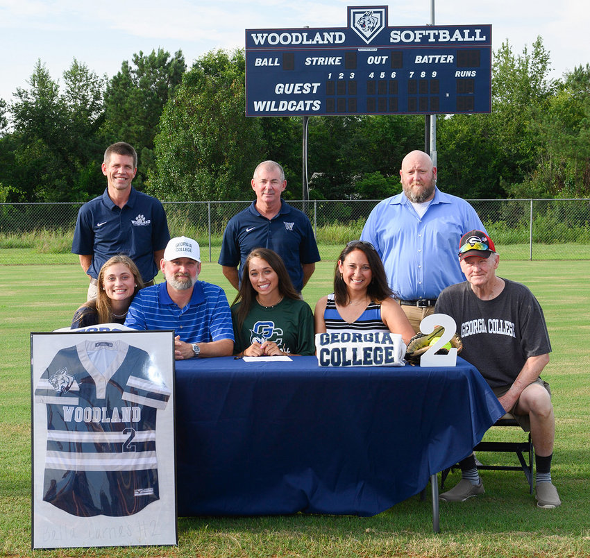 Woodland Class of 2020 graduate Bella Carnes signed Sunday to play softball with Georgia College in Milledgeville. On hand for the signing were, from left, front row: Alana Carnes, sister; Carey Carnes, father; Vanessa Carnes, mother; James Breeden, grandfather; back row, David Stephenson, WHS principal; Colman Roberts, WHS head softball coach; and Matt Bowen, WHS assistant softball coach.