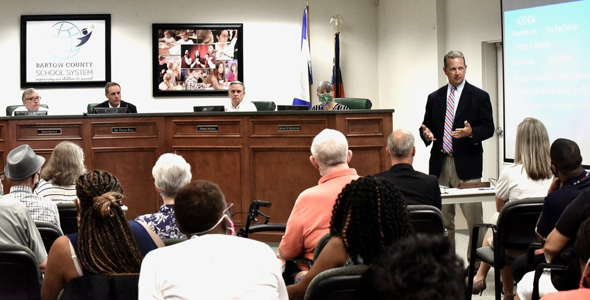 Bartow County School Board attorney Shep Helton speaks to the crowd about what the board can do legally to remove a board member at Wednesday's called meeting.