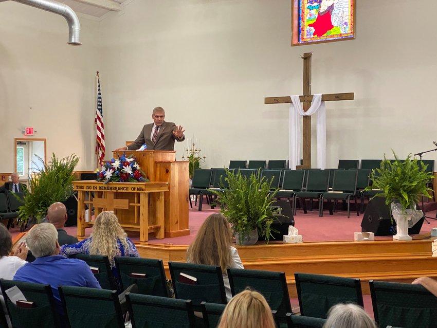 United States Representative Barry Loudermilk speaks at Creekside Fellowship Church.