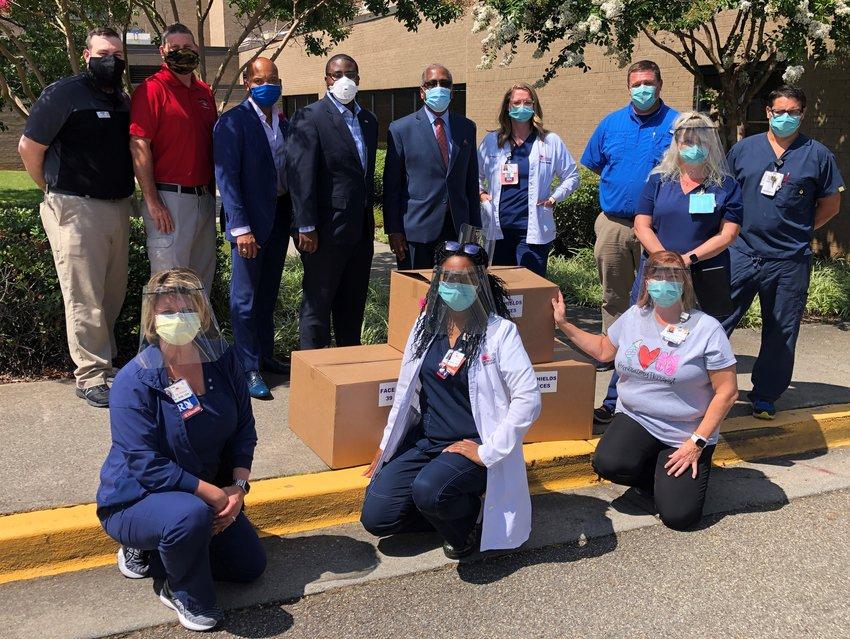 Matthews Kia donates 115 face shields to Cartersville Medical Center's ER, ICU and nursing units.