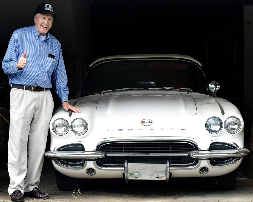"Harold McCoy, 80, gives a thumbs-up sign beside his 1962 Chevrolet Corvette. The Kingston resident's classic car collection will be showcased Monday at 9 p.m. on the History Channel's reality TV show ""American Pickers."""
