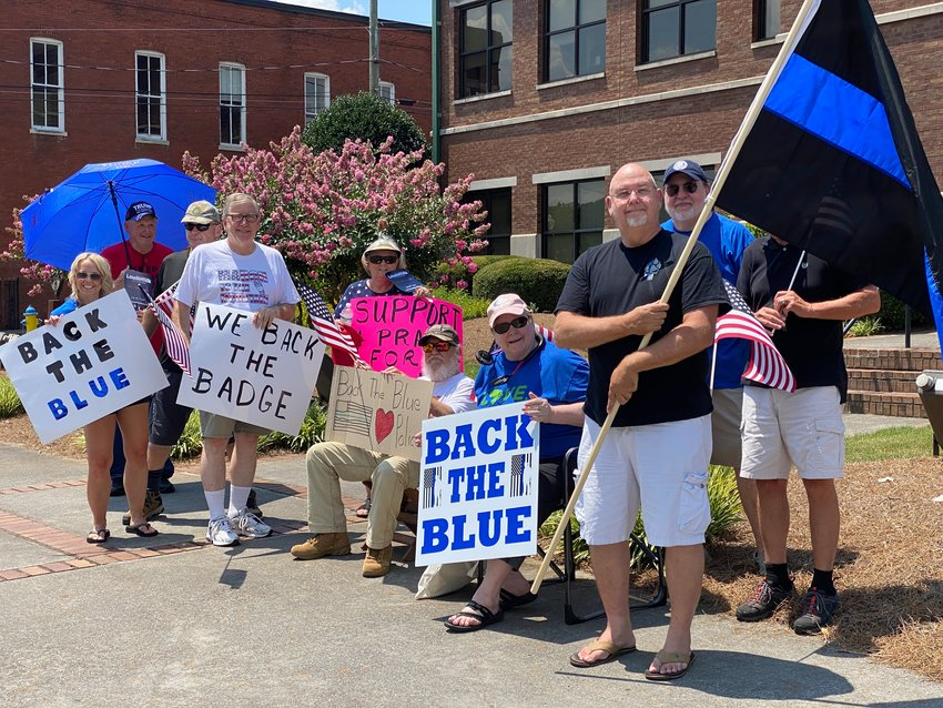 "About three dozen people showed up for a ""back the blue"" demonstration in downtown Cartersville on Saturday afternoon."