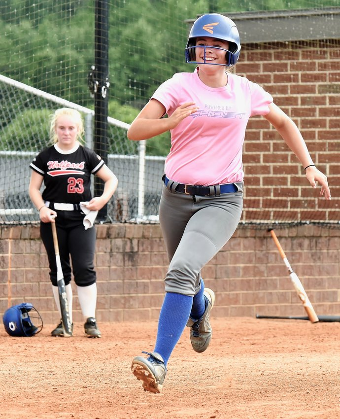 Cass rising sophomore Ansley Hight heads for home during a workout Thursday.