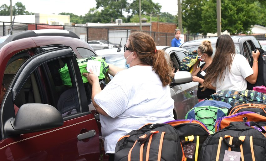 Volunteers handed backpacks filled with school supplies to parents and students at six locations, including Cartersville High School, during Bartow Give a Kid a Chance.
