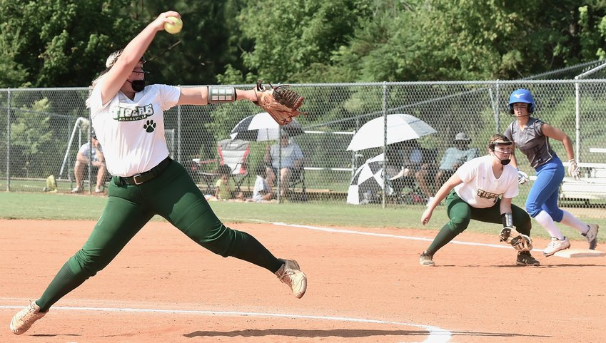 Adairsville senior Victoria O'Neal pitches against Armuchee as first baseman Jenna Young and a baserunner look on during Saturday morning's 5-1 home win. O'Neal struck out 12 in a complete-game performance.