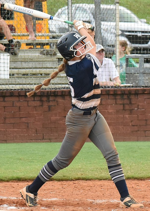 Woodland senior Morgan Cooper watches her two-run homer in the bottom of the fourth inning clear the center-field fence in an eventual 8-0 win over Hiram Thursday at home.